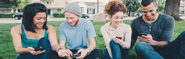 teens playing with cell phone
